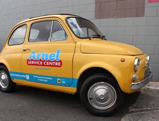 Yellow car with logo reading Arnel service centre