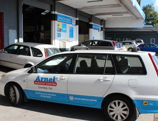 White car with Arnel service centre logo on door